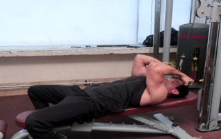 Lying on Flat Bench Cable Curl Exercise