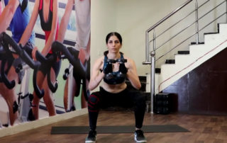 standing squat with dumbbells